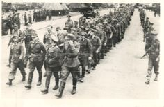 WWII German Prisoners March To Camp After Capture on French Beach Press Photo