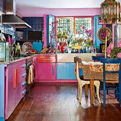 Self Architecture - hand made kitchen with bright cabinets make for a colourful kitchen More