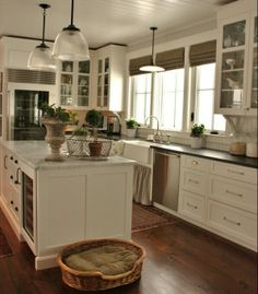 Many nice details in this kitchen ~ beadboard backsplash, blinds, paint cabinets white.. Paint knobs and handles black, add bead board instead of backsplash add a new countertop or paint the one we have!!! This is my kitchen.. No more looking!!! :0)