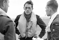 """RAF Squadron Leader BJE 'Sandy' Lane, pictured here aged only 23 at the height of the Battle of Britain in September 1940. The strain is evident on his face, although he exudes a quiet confidence - a sentiment reflected in this quote from his comrade and friend George Unwin:    """"He was completely unflappable, no matter what the odds, his voice always calm and reassuring, issuing orders which always seemed to be the right decisions."""" Sadly, Sandy was killed two years after this photo was take..."""