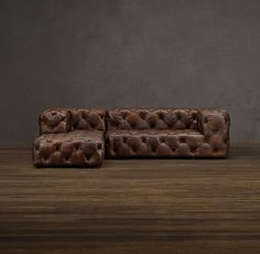 Grandly proportioned, with a low seat, plush padding and allover button tufting, our Soho sofa is comfort writ large. Its lavish styling recalls the classic Chesterfield – plush seating for London's turn-of-the-century gentlemen's clubs – but squared-off arms and a rakishly low profile imbue it with contemporary, of-the-moment style.