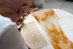 Arne Ase using shellac on greenware porcelain