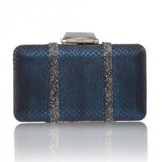 The Espey Elaphe with Crystal Embellishment in Metallic Navy is a rectangular box clutch wrapped with snakeskin. With a cut glass clasp, KOTUR's signature brocade lining and featuring a drop-in shoulder chain, this medium-sized minaudiere fits two smartphones plus evening essentials.