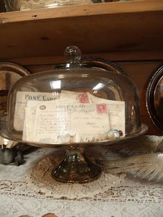old letters & post cards in a cloche.