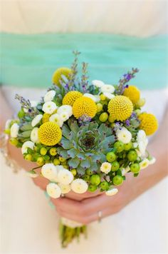 This green living plant bouquet is natural and exotic and features colour pops of yellow and purple.
