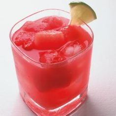 Watermelon Gin Fizz    5 cups diced watermelon, divided  6 ounces gin, divided  8 tablespoons lime juice, divided  1 1/3 cups ginger ale, divided  Lime wedges, for garnish