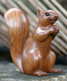 Wood sculpture, 'Squirrel with an Acorn'. Shop from #UNICEFMarket and help save the lives of children around the world.