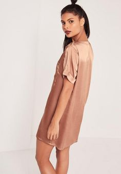 Keep it simple, babe. This brown little number will have you lookin' lush and feelin' fresh with just a click of a button. Silky soft to the touch and in a button down, shirt style, wear with heels and a clutch for a red carpet ready look.