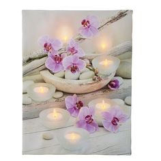 Here we have a Led Lighted Orchid Canvas. With a lovely glow, this beautiful canvas adds a lovely look to your home. Featuring gorgeous orchids, rocks...