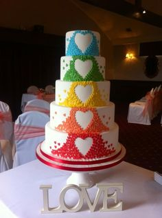 Love (don't really like the letters on the table, but do like the heart shapes in the different colors on the tiers of the cake)