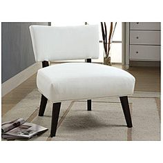 Sleek craftsmanship for a contemporary home, bedroom or office, this cream faux leather accent chair features unique rectangular shaped back and seat cushion with dark brown frame echoing contemporary delight.