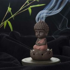 This peaceful incense burner is the perfect housewarming gift! Watch with fascination as scented smoke drifts off the peaceful Buddha's head.