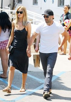 Matching: The lovebirds both wore sandals and sunglasses to the beach cafe