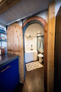 Tiny Adventure House – Tiny House Swoon--I love the curved door, the tile (and the tub)! #tinybathrooms