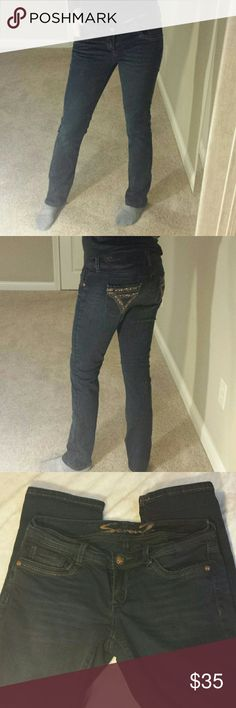 """Like New Seven 7 Jeans Adorable and like new, dark wash, straight leg, Seven7 jeans. Cute bronze and crystal detail on back pockets. Nice stretch since they are made with cotton and spandex. Very flattering, soft and comfy. I am normally a 5/6 and these fit well. Measure 16"""" across waist when laying flat. Inseam is 30 1/2"""". *Smoke Free Home* Seven7 Jeans"""