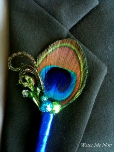 Peacock Boutonniere for your Peacock Wedding-Customize this Short Trim around the peacock eye boutonniere. $11.00, via Etsy.