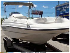Visit www.FloridaBoatAds.com 1998 Bayliner 2109 powered by 2001 Mercury 150 hp EFI outboard, bimini top, boat cover, new snap in carpet, new battery, new hydraulic steering, transom shower, and only 275 hours. Seating for family and friends! Roomy private area for porta potti, and, or storage. You must see this boat to appreciate, no tears, sun damage, like brand new! Transport trailer is not included.