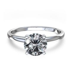 Absolutely perfect. Timeless Four-Prong Round Solitaire Engagement Ring in Platinum.