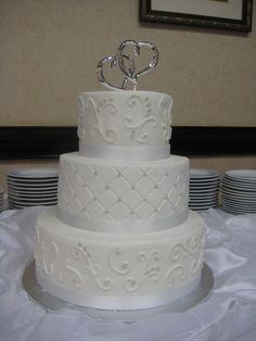 3 Tier Round Wedding Cake With Scrollwork And Diamond Pattern