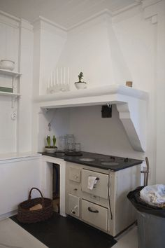 love the style of the kitchen and the old oven/stove