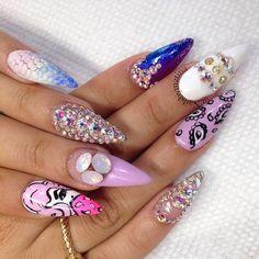 I'm not a fan of how long the nails are, but I like the designs!