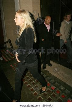 18.JANUARY.2007. LONDON A DRUNK PRINCE HARRY AND GIRLFRIEND CHELSY DAVY LEAVING CUKOO CLUB, MAYFIR AT 3.00AM. THIS IS THE LAST TIME THEY WILL SEE EACHOTHER IN A WHILE BECAUSE SHE IS GOING BACK TO SOUTH AFRICA. Stock Photo
