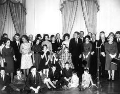 AR6287-F. Sworn-In Cabinet Members and their Families Pose with President John F. Kennedy and Jacqueline Kennedy - John F. Kennedy Presidential Library  Museum