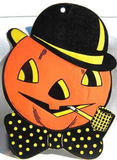 Vintage Halloween Decoration...nothing like a corn cob pipe smoking Jack-O-Lantern!