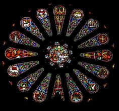 Harry Clarke was a very famous Irish stained glass artist.  This rose window is in St. Brigid's Catholic Church in San Francisco, California.  The historic Nob Hill church, sadly, is now closed to the public and owned by the Academy of Art Institute.