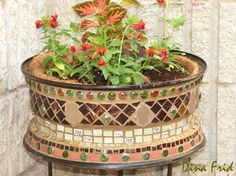 Mosaic flowerpot made from a tire rim.