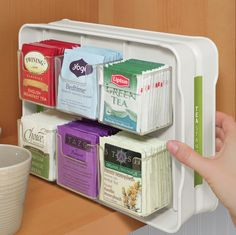 20 Kitchen gadgets you didn't know you needed: YouCopia Tea stand 100 Tea bag organizer I usually drink loose leaf tea, but I'd be willing to change for the compactness and organization of this little guy!
