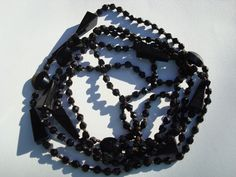 Antique black glass French sautoir necklace, jet black beads, hand knotted cotton, 64 inches, hand cut small beads ? by snapconclusions on Etsy