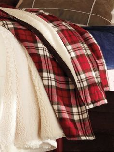 Sherpa and red plaid, oh my! Red is the primary accent colour highlighted throughout the apartment