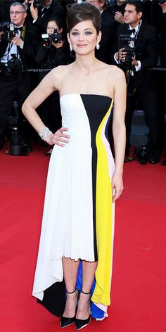 Marion Cotillard arrives for the screening of 'Blood Ties' at the 66th international film festival, in Cannes, southern France in Dior's Cruise 2014 dress, May 20, 2013.