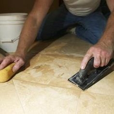 Waterproof your self-stick tile by adding grout and caulk to the joints before sealing the entire surface.