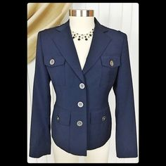 MICHAEL Michael Kors Stretch Wool Military Blazer MICHAEL Michael Kors Stretch Wool Blend Military Blazer. Women's size 8 (fits like a 6/8). This navy blue blazer is as comfortable as it is classic! The military style jacket is always in fashion and can be dressed up for the office or dressed down on the weekend. Designer buttons, shoulder loops, flap front pockets, with classic lines. The 2% spandex blend gives this jacket stretch while the wool blend is perfect for the fall-winter-spring…
