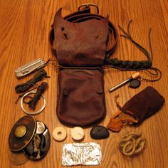 Leatherman Wave, paracord, wire, HBC tobacco tin (char, jute, flint, striker knife, tinder fungus, small ferro, leather pad, burning lens in lid, char cooker.), dental floss, candle, stone bearing, tinfoil, tinder bag (fungus, steelwool, cedar, jute), Ferro rod, photon light, 2 3ft lengths of paracord tied to belt.