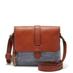 Kinley's mini crossbody packs a (pretty) punch with an eye-catching exterior pocket and cotton chambray silhouette.*Will be shipped separately from other products