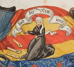 """wooden spoons lie on ground beside seated woman who points to banderole reading """"Had dir Nitt mir"""" [? don't quarrel with me] -- detail of adjacent"""