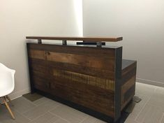 This contemporary reception desk made with reclaimed Louisiana cypress and raw steel. The top beam is perfect for signing people into a business. It makes a strong impression in any environment. Dimensions: 76x42H Desktop 28 deep