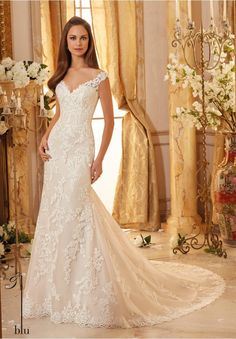 Wedding Gowns By Blu featuring Classic Embroidered Lace on Soft Tulle with Scalloped Hemline Available in Three Lengths: 55', 58', 61'. Colors Available: White, Ivory, Ivory/Light Gold