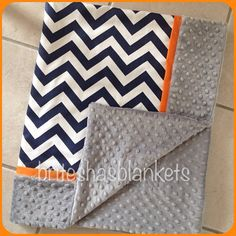 This listing is for a chevron, orange trim and minky dot blanket. Soft and snuggly and very durable. It is made with navy chevron and grey minky