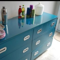 I think I can turn two Ikea Rast dressers into this with shiny lacquer and new hardware. This is a must do for our bedroom!