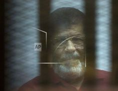 CAIRO/December 30, 2017  (AP)(STL.News) —An Egyptian court Saturday convicted former Islamist President Mohammed Morsi and 19 others of insulting the judiciary, sentencing them to three years in prison in a court session aired on TV. The case involves 25 defendants, five of whom — including promi... Read More Details: https://www.stl.news/egypt-court-jails-ousted-president-ove-insulting-judiciary/58511/