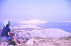 Anthony Sargeant took this photograph of Gill sitting on a rock just off the coast road in Yugoslavia when on holiday in 1966 - looking out across the beached white limestone islands and the Adriatic. Council Estate, South London, Landscape Photographers, Family Photographer, Grand Canyon, Coastal, Europe, Islands, Canon 35mm