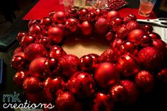 MallyKally Creations: #DIY: Ornament Wreath will be the pop of color that your front door needs.