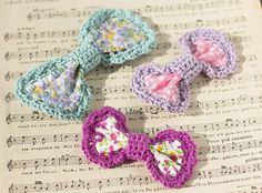 Crochet edges on fabric scraps for a cute bow to pin wherever.  Tutorial by Mon Petit Four.  A great project for our Bonbons yarn.
