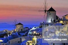 Windmills at sunset, Oia, Ia, Santorini, Cyclades, Greece, Europe