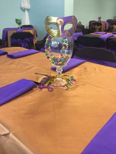 Simple Mardi Gras Party Centerpieces by Esyntial Elements Consulting Inc.