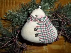 Hey, I found this really awesome Etsy listing at https://www.etsy.com/listing/253627283/primitive-snowman-ornament-hand-made